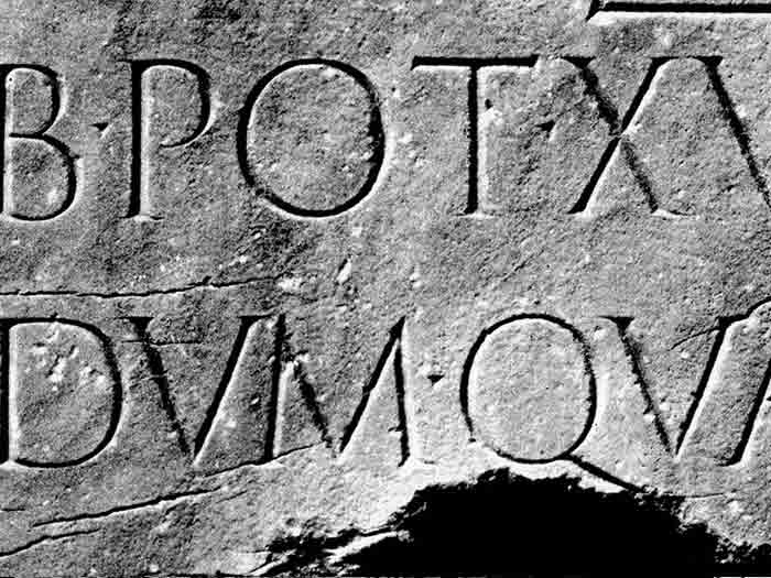 Carved roman inscription on stone
